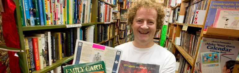 City Lights Bookstore co-owner Jim Capel holds a biography of Emily Carr, inside which a $10,000 Canada savings bond from 1981-82 was found, in the Richmond Street bookshop in London. Craig Glover/The London Free Press/Postmedia Network
