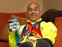 Roy Van Amerom dons medallions earned by his feet in marathons the world over. The Londoner recently became one of only about 600 people in the world who have finished all six major marathons in the last 10 years. (DEREK RUTTAN, The London Free Press)
