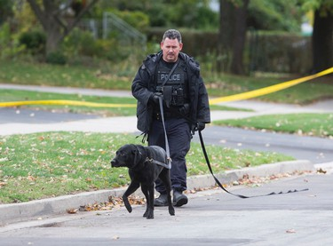 Police investigate a shooting death on Windsor Rd., near Kipling Ave. and Dixon Rd. in Toronto, Ont. on Monday October 24, 2016. The deceased was found in the black SUV. Ernest Doroszuk/Toronto Sun/Postmedia Network