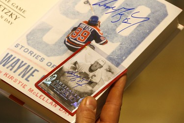 Nathan Kozey got a LA Kings hockey card signed by Edmonton Oilers great Wayne Gretzky at a book signing at West Edmonton Mall in Edmonton, Alberta on Monday, October 24, 2016. Ian Kucerak / Postmedia
