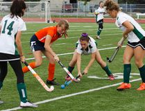 Bayridge Blazers' Maria Amsden battles with Holy Cross Crusaders' Caleigh Patterson for possession of the ball during a Kingston Area Secondary Schools Athletic Associations girls field hockey game at CaraCo Field on Oct. 4. (Julia McKay/The Whig-Standard)
