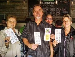 Craft beer explorers Marie Hood, left, Mike Boniface, Natalie Gentle and Cynthia Gentle were the first with fully stamped HOP ME passports after visiting 10 London-area breweries. (Contributed)