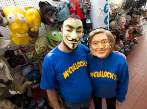 Dale McCulloch, left, sports a Guy Fawkes mask, while Hunter McCulloch wears a Hillary Clinton mask, both big sellers this Halloween at McCulloch?s on Dundas Street in London. (CRAIG GLOVER, The London Free Press)