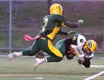 Lockerby Vikings David Pushman gets taken down by Curtis Theobald of the Confederation Chargers during senior boys high school football action in Sudbury, Ont. on Tuesday October 25, 2016. Gino Donato/Sudbury Star/Postmedia Network