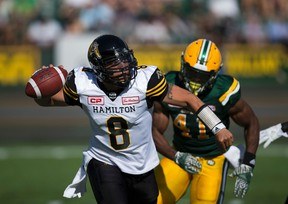 Eskimos' Odell Willis (41) chases Tiger-Cats QB Jeremiah Masoli (8) during first half CFL action at Commonwealth Stadium in Edmonton on Saturday, July 23, 2016. (Greg Southam/Postmedia)