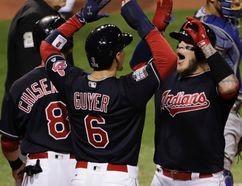 Indians' Roberto Perez (right) celebrates with Brandon Guyer (6) and Lonnie Chisenhall (8) after hitting a three-run home run during the eighth inning of Game 1 of the World Series against the Cubs in Cleveland on Tuesday, Oct. 25, 2016. (Gene J. Puskar/AP Photo)