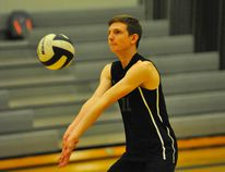 Holy Trinity's Karl Wilhelmus bumps the ball during a NSSAA junior boys volleyball contest vs. the Delhi Raiders on Tuesday. Holy Trinity won the match 3-2. JACOB ROBINSON/Simcoe Reformer