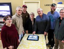 NOW's board of directors cuts the cake on the group's 10 year anniversary.