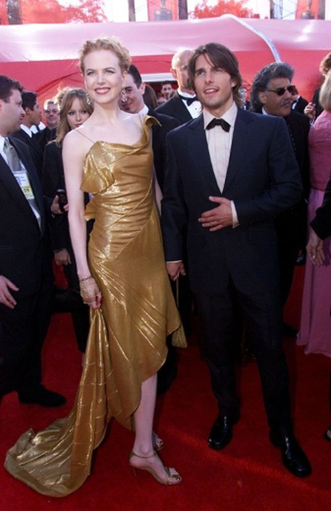 "Nicole Kidman, wearing a Dior gold dress with gold antique gloves, is pictured with then-husband Tom Cruise at the Oscars. (<A HREF=""http://www.wenn.com"" TARGET=""newwindow"">WENN.COM</a> file photo)"