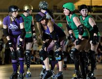 Victoria's Eves of Destruction, in purple, and the E-Ville Dead exchange hard looks on the starting line during Roller Derby action at the Edmonton Sports Dome. Amber Bracken, Postmedia Network.