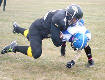 Can't stop, won't stop. #55 Dawson Veno, Guard, took possession of the ball and refused to be held down during the Hanna Hawks Oct. 17 game against the Camrose Royals. The Hawks won the game 46-16.