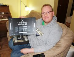 Raymond Northcott with his board game invention The Hackers Guild at his Ashern home. (Juliet Kadzviti, Interlake Publishing, Postmedia Network)