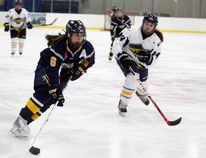 Logan Clow/Daily Herald-Tribune Dayle Ross, of the Bonnett's Energy Bantam AA Elite Peace Country Storm, takes the puck to the net against the North Central Impact in Alberta Female Hockey League play earlier this month at the Coca-Cola Centre.