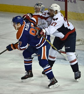 Capitals defenceman Karl Alzner, shown here pushing Connor McDavid in front of the Washington net during a game last season, planned to ask the Oilers captain for his stick after Wednesday's game. (Ed Kaiser)