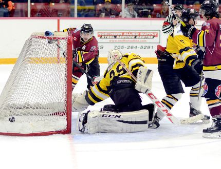 Timmins Rock forward Wayne Mathieu deposits a shot into the Iroquois Falls Eskis net behind goalie Trevor Hawkes during the third period of Wednesday night's NOJHL game at the McIntyre Arena. Mathieu's 10th goal of the season closed out the scoring, as the Rock went on to defeat the Eskis 5-2. It was the fourth-straight victory for the Rock who will head out on the road for games against the Powassan Voodoos Friday night and the French River Rapids Saturday night. THOMAS PERRY/THE DAILY PRESS