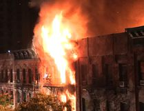 Flames rise from an apartment building fire on the Upper East Side in New York on Thursday, Oct. 27, 2016. The flames quickly spread throughout the building and were shooting out the roof at one point, sending burning embers onto nearby buildings. (Matt Bonaccorso via AP)