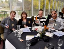 From left, award winners Rylan Schwarze, Nathalie Lavergne, Amund Christensen and Ahmad Khadra pose at the Brockville Country Club after the Bridges to Better Business event on Thursday. (RONALD ZAJAC/The Recorder and Times)
