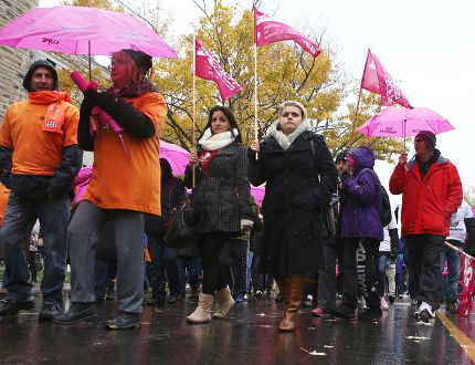 Members of health-care unions from across Ontario rally in front of Kingston General Hospital against health-care funding cuts and the planned merger of KGH and Hotel Dieu Hospital on Thursday. (Elliot Ferguson/The Whig-Standard)