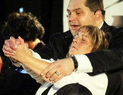 At one of the fundraising shows for Brenna Schellenberg, Matao the Master Mind Hypnotist, puts a volunteer to sleep. Matao's show was at Happy Thought School Oct. 22 and included a peformance by illusionost 'El Toddo.' (Glen Hallick, Interlake Publishing, Postmedia Network)