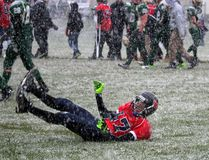 Brady McDonald of St. Joseph's goes for a celebratory post-game slide in the snow, after the Panthers defeated Holy Trinity 34-9 in their SD&G High School Football League playoff game at St. Joe's on Thursday. Kevin Gould/Cornwall Standard-Freeholder