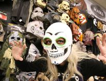 Julie Jacques a sales associate at Spirit Halloween on Notre Dame Ave. dons a mask in Sudbury, Ont. on Thursday October 27, 2016. The forecast for Halloween Monday calls for a high of 7 with a chance of showers.Gino Donato/Sudbury Star/Postmedia Network