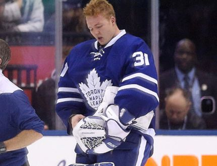 Maple Leafs goalie Frederik Andersen gets cut by the stick of Panthers' Colton Sceviour in the third period as the Leafs went on to beat the Panthers 3-2 in Toronto on Thursday, Oct. 27, 2016. (Stan Behal/Toronto Sun)