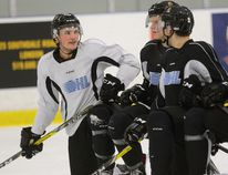 London Knights forward Cole Tymkin, left, during a break in practice at the Western Fair on Thursday October 27, 2016. (MORRIS LAMONT, The London Free Press)