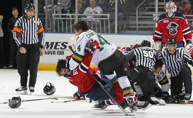 Jacob Cascagnette #62 of the Kitchener Rangers is knocked down by Brandon Crawley #14 of the London Knights during an OHL game at Budweiser Gardens on October 20, 2016 in London, Ontario, Canada. The Knights defeated the Rangers 5-4.(Photo by Claus Andersen/Getty Images)