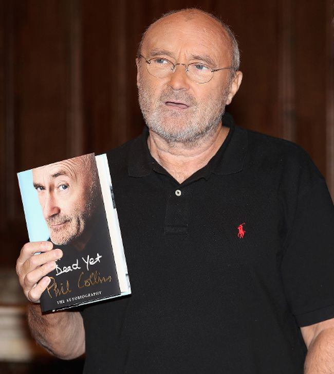Phil Collins poses with a copy of his autobiography Not Dead Yet  on October 18, 2016 in London, England. (Photo by Chris Jackson/Getty Images)