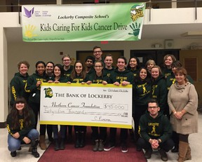 Members of the LCS Kids Caring for Kids Cancer Drive organizing committee present Tannys Laughren, executive director of the NCF, with a cheque for $45,000. Supplied photo