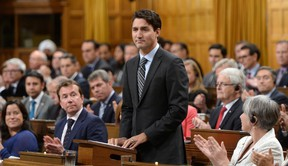 """Prime Minister Justin Trudeau delivers a speech at the start of the Paris Agreement debate in the House of Commons on Parliament Hill in Ottawa on Monday, Oct. 3, 2016. Trudeau announced the federal Liberal government will establish a """"floor price'' on carbon pollution of $10 a tonne in 2018, rising to $50 a tonne by 2022. (THE CANADIAN PRESS/Sean Kilpatrick)"""