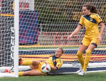 Queen's Gaels' Erin Cliffe dives at her own goal-line to stop a ball that got past goalie Madison Tyrell during an OUA women's soccer playoff game at Richardson Stadium on Sunday. Looking on is the Gaels' Rachel Radu. Queen's won 1-0 in overtime. (Tim Gordanier/The Whig-Standard)