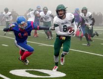 St. Joe's Celtics' Silas Yelenik, right, eludes Tyler Jack, of the PWA Titans during a foggy Mighty Peace Football League semi-final on Saturday at CKC Field. Despite a heavy blanket of fog over the field, the Celtics won 45-7 to advance to the Peace Bowl final. Logan Clow/Daily Herald-Tribune