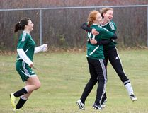 Melissa Gilligan (10) celebrates with Stephanie Leask, after Gilligan scored to make it 2-0 for Holy Trinity in the SD&G senior girls AA soccer final at HT on Monday. At left is Dara Laframboise. The Falcons beat St. Joseph's 3-0 in the final, with Gilligan scoring all three goals. Kevin Gould/Cornwall Standard-Freeholder