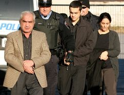 Mohammad Shafia (left), his wife Tooba Mohammad Yahya and their son Hamed arrive for court in KIngston on December 12, 2011. They are each charged with four counts of first degree murder in the deaths of four other family members. Their bodies were found in a submerged car in the Kingston Mills Locks on June 30th 2009. IAN MACALPINE/Postmedia Network