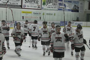 The Whitecourt Wolverines celebrate after a 4-1 victory versus the Olds Grizzlies on Oct. 28. The Wolverines won both their home games on the weekend and have won seven of their past eight, putting them near the top of AJHL standings.
