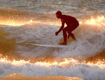 The sun kisses the waves at Kincardine's Station Beach as a surfer takes to the waves. (Shared photo by Jerry Fabian)