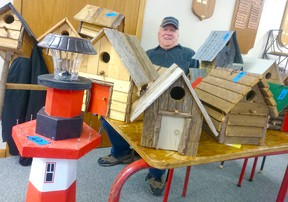 The Point Clark Community Centre saw 29 vendors and about 175 people out for the Huron Lakeshore Friendship Club Christmas Craft Show on Oct. 29, 2016. Pictured: 'The Bird Man' Roy Douglas of Point Clark, shows off the birdhouses he makes from barn boards, branches, and other materials that he has been shipping abroad this year. (Troy Patterson/Kincardine News and Lucknow Sentinel)