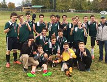 The Nicholson Crusaders celebrate their COSSA A junior boys soccer championship Tuesday in Port Hope.