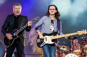 Alex Lifeson, Geddy Lee and Neil Peart of Rush performing at RBC Bluesfest in Ottawa. July 8, 2013. Errol McGihon, Postmedia Network