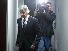 Dr Norman Barwin makes his way to the disciplinary hearing at the College of Physicians and Surgeons in 2013. Chris Young/Postmedia