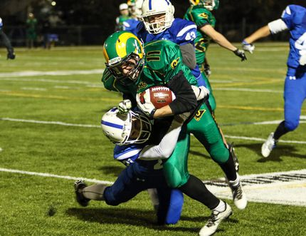 Bryce Woodrow of the Lacombe Composite High School Rams tries to escape a tackle by Austin Schneider of the Hunting Hills High School Lightning during Central Alberta High School Football semifinal playoff action at M.E. Global Field Friday night. The Rams lost to the Lightning 22-13. (Ashli Barrett, Lacombe Globe)