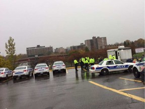 Police assemble for a morning briefing at Lincoln Fields on Thursday in the search for an 86-year-old woman with 'advanced dementia.' Tom Spears TOM SPEARS / POSTMEDIA