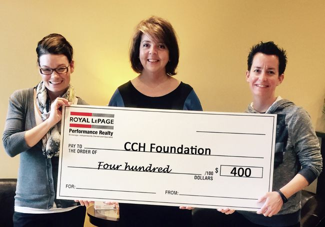 Royal LePage sales rep Jen Blair Manley and assistant Christal Bowen present a $400 donation to Cornwall Community Hospital Foundation's Angela Preston. The duo are the Dream Team behind the PINK movement for breast cancer. Messages from the two shared on Facebook generated $1, which Blair Manley matched.