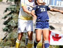 Allison Pilon of the Laurentian Voyageurs womens soccer team battles to head the ball with Julia Previte of the Nipissing Lakers soccer team during OUA soccer action from Laurentian Field in Sudbury, Ont. on Sunday September 11, 2016. Pilon was named the winner of the OUA East Division Community Service Award this week for her work with Free the Children. Gino Donato/Sudbury Star/Postmedia Network