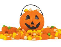 A small Halloween /jack o Lantern pail with a pile of Candy. Aurora Dental Group Lacombe offers oral hygiene tips. (Getty Images/iStockphoto)