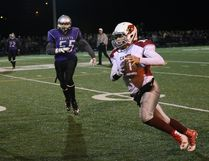 Nathan Rivet, right, of St. Charles College Cardinals, runs for a first down during the senior boys football final against the Lo-Ellen Knights at James Jerome Sports Complex in Sudbury, Ont. on Friday November 4, 2016. The Cards won 28-6. See www.thesudburystar.com for a full story. John Lappa/Sudbury Star/Postmedia Network