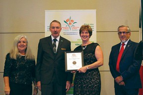 Pincher Creek was awarded a 5 Blooms Bronze rating and a certificate of honourable mention. Diane Burt Stuckey received the certificate during the Communities in Bloom awards ceremony in Regina, Sask. | Photo courtesy of Communities in Bloom Facebook