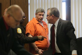 Charles Pickett Jr., center, arrives for a preliminary examination before Judge Vincent Westra in Kalamazoo County District Court Monday, Nov. 7, 2016. Picket is charged with multiple murder and reckless driving felonies for the June 7 North Westnedge Avenue crash where he drove into nine bicyclists. (Mark Bugnaski/Kalamazoo Gazette-MLive.com via AP)
