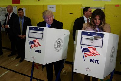 Republican presidential candidate Donald Trump, and his wife Melania, casts their ballots at PS-59, Tuesday, Nov. 8, 2016, in New York. (AP Photo/ Evan Vucci)